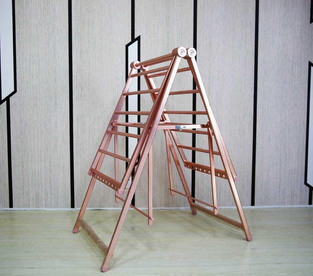 sushilka-dlya-belya-na-balkon-foto-video-vidy-sposoby-ustanovki-i-tipy-konstruktsij-11